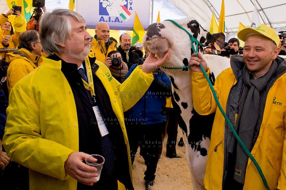 """Roma 6 Febbraio 2015<br /> Manifestazione in Campidoglio, per «difendere il latte italiano», organizzato dalla Coldiretti, e l'Associazione italiana allevatori che  hanno portato le  mucche  nelle piazze italiane per sensibilizzare opinione pubblica e istituzioni sulla crisi del settore lattiero-caseario. Il ministro del Lavoro Giuliano Poletti con la mucca della Coldiretti.<br /> Rome February 6, 2015<br /> Demostration  at the Capitol, to """"defend the Italian milk"""", organized by Coldiretti, and the Association of Italian farmers who brought the cows in the Italian squares to sensitize public opinion and institutions on the crisis of the dairy sector. The  Minister Labour  Giuliano Poletti, with the cow of the Coldiretti."""