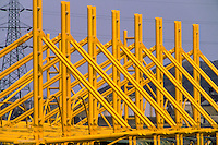 Bright yellow steel roof frame during the construction of the Don Valley Stadium Sheffield.