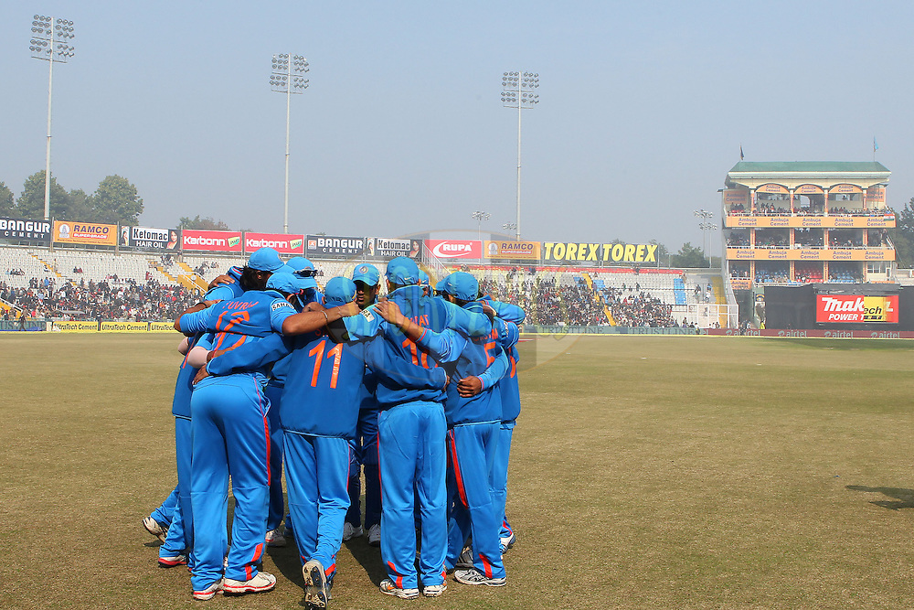 Team India huddle as they prepare to field during the 4th Airtel ODI Match between India and England held at the PCA Stadium, Mohal, India on the 23rd January 2013..Photo by Ron Gaunt/BCCI/SPORTZPICS ..Use of this image is subject to the terms and conditions as outlined by the BCCI. These terms can be found by following this link:..http://www.sportzpics.co.za/image/I0000SoRagM2cIEc