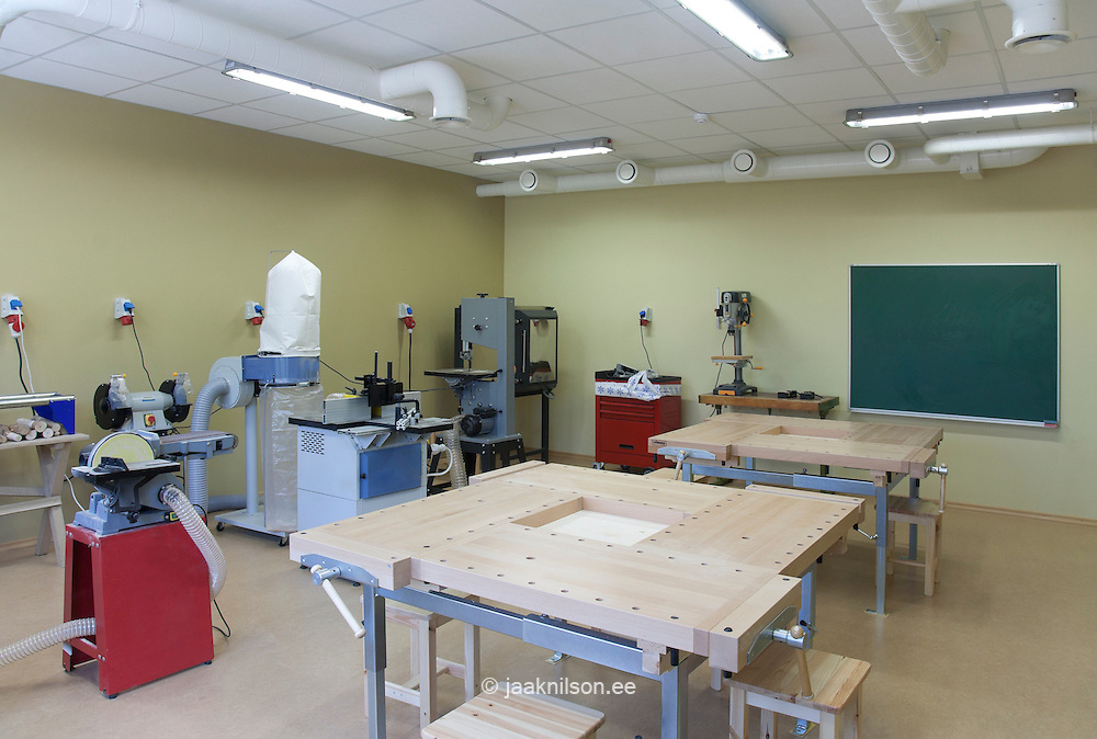 Village school in Metsapoole, Estonia. Classroom set up for  technical or practical course. Woodwork or light engineering. Machines and work surfaces. Workshop.