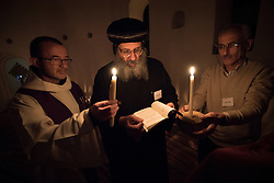 14 December 2016, Cairo, Egypt: Coptic Orthodox Bishop Luke from Egypt reads a prayer during Eucharistic Mass celebrated at the Anafora Church, part of the Anaphora Institute, a Coptic Orthodox retreat and educational centre located north-west of Cairo. The mass was led by Cardinal Philippe Barbarin of the Roman Catholic Church.