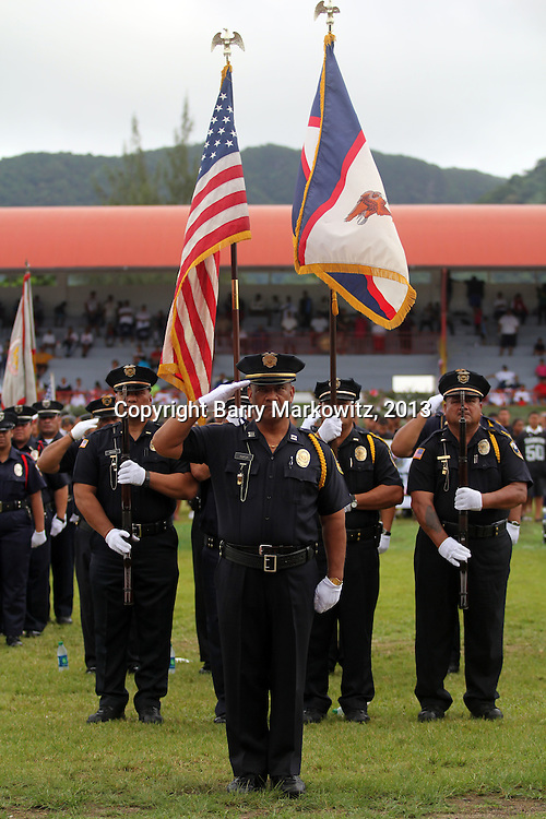 Proud American Samoa police officers serve as the Honor Guard for the 2013 American Samoa Flag Day Ceremonies, Veterans Stadium, Tafuna, Tutuila, American Samoa.  Photo by Barry Markowitz, 4/17/13, Courtesy Samoa Tuna Processors/Tri Marine Group