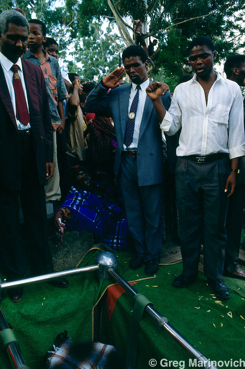 Table Mountain, KwaZulu Natal South Africa 1993: Inkatha supporters bury victims of an ambush during ANC IFP clashes in Table Mountain area of Kwa Zulu Natal.