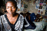 "Tatatza Tiutanhira, 28 years old from Unit O District in Chitungwiza lies doubled up in agony with Cholera as his girlfriend waits for transport to admit him to a treatment centre...As of 30 May 2009, there were 98 424 suspected cases, including 4 276 deaths reported by the Ministry of Health and Child Welfare (MoHCW) of Zimbabwe since August 2008. Fifty-five out of 62 districts in all 10 provinces were affected. in December 2008, Robert Mugabe declared that ""there is no cholera"" in Zimbabwe. Failing sanitation and lack of water supply were to blame, workers responsible claimed they had not been paid by the government for several months."