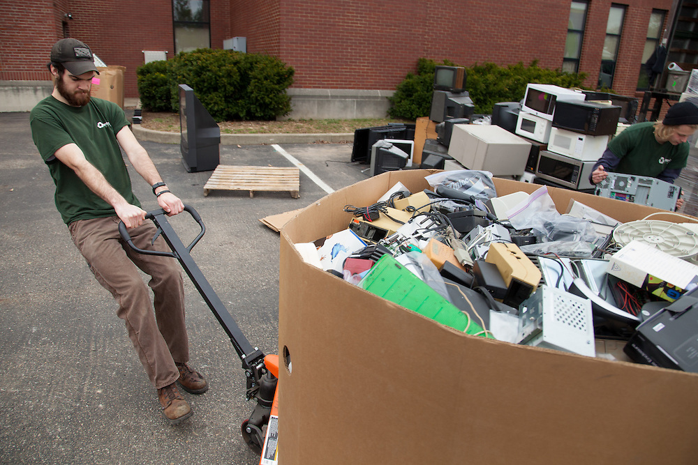 Jeremy Martin drags a box full of electronics the community dropped off on Saturday as part of the Electronics Recycling Day.  The electronics will be stripped down for their various components separated out to be recycled.  Photo by Ohio University / Jonathan Adams