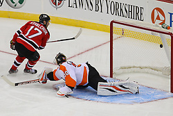 Jan 22, 2013; Newark, NJ, USA; New Jersey Devils left wing Ilya Kovalchuk (17) scores a penalty shot goal on Philadelphia Flyers goalie Ilya Bryzgalov (30) during the second period at the Prudential Center.