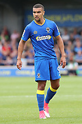 AFC Wimbledon striker Kweshi Appiah (9) looking towards another player during the EFL Sky Bet League 1 match between AFC Wimbledon and Shrewsbury Town at the Cherry Red Records Stadium, Kingston, England on 12 August 2017. Photo by Matthew Redman.