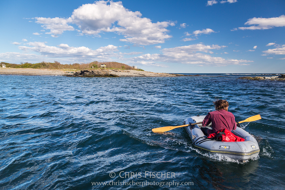 Stratton Island Supervisor John Gorey rows supplies ashore in a rubber dinghy. Researchers and interns live and work on the island during the field season. This 24-acre island is the centerpiece of the Phineas W. Sprague Memorial Sanctuary, which is owned and run by the National Audubon Society. Stratton Island is located in Saco Bay, 3 miles east of Old Orchard Beach, Maine.
