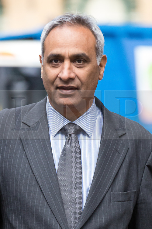 © Licensed to London News Pictures. 28/07/2015. London, UK. Former Metropolitan police sergeant, Gurpal Virdi arrives at Southwark Crown Court in London. Virdi appears in connection with allegedly racially and sexually abusing a 16 year old boy in the back of a police van 29 years ago. Photo credit : Vickie Flores/LNP