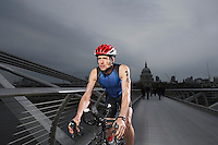 Cyclist riding on foot bridge Millennium Bridge London England