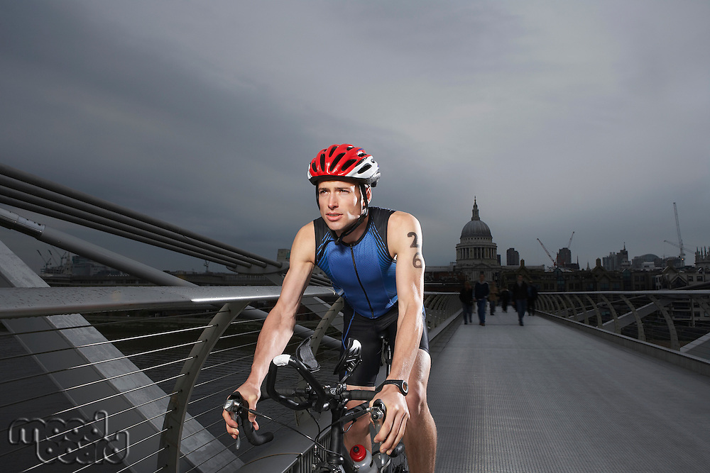 Cyclist riding on foot bridge Millennium Bridge London England