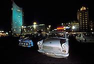 GDR, German Democratic Republic, Leipzig, Trabant cars at the Karl-Marx square (today Augustus square), in the background the City skyscraper.....DDR, Deutsche Demokratische Republik, Leipzig, geparkte Trabis auf dem Karl-Marx-Platz (heute Augustusplaz), im Hintergrund das City-Hochhaus...Januar/January 1990......