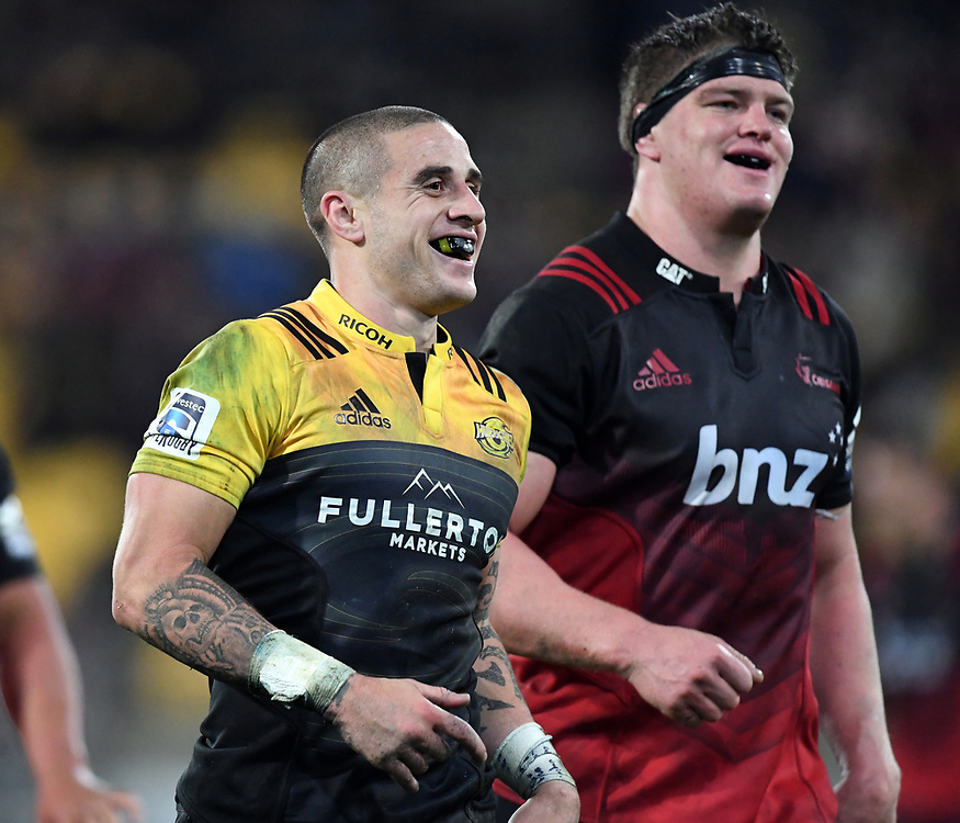 Hurricanes TJ Perenara, left, all smiles after kicking the ball to touch for the win over the Crusaders in Super Rugby match at Westpac Stadium, Wellington, New Zealand, Saturday, July 15, 2017. Credit:SNPA / Ross Setford  **NO ARCHIVING""