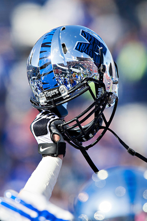 MEMPHIS, TN - OCTOBER 17:  Player holds up helmet of the Memphis Tigers before a game against the Ole Miss Rebels at Liberty Bowl Memorial Stadium on October 17, 2015 in Memphis, Tennessee.  The Tigers defeated the Rebels 37-24.  (Photo by Wesley Hitt/Getty Images) *** Local Caption ***