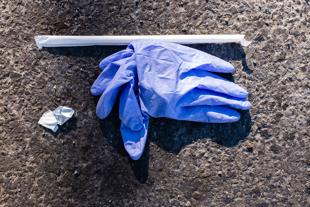 Brooklyn, NY - 27 March 2020. Restrictions on the public during the COVID-19 pandemic have led shortages of surgical masks and gloves. Despite the scarcity, both are often discarded, and can be found on the city's streets and sidewalks.