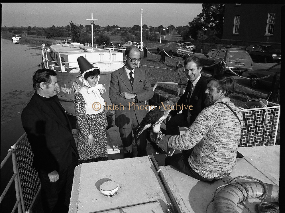 Robertstown Grand Canal Festival.  (N87)..1981..30.07.1981..07.30.1981..30th July 1981..A reception was held today to announce the launch of the Annual Grand Canal Festival at Robertstown, Co Kildare. The festival features a series of weekend family entertainments in August/September. This years event will be sponsored by Guinness Group Sales, Irl Ltd...At the reception to launch the Robertstown Grand Canal Festival were, Fr Alphonsis Murphy, C C Prosperous, Director, Management Board,Robertstown Muintir na Tire, Ms Moll Fullam,Robertstown Drama Group, Mr John Kinahan, Guinness Marketing Dept, Mr Joe Greevy, Chairman, Festival Committee and Mr Michael Comyns, Falconer with his red tailed hawk on board one of the barges.