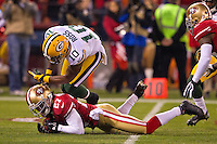 12 January 2013: Wide receiver (10) Jeremy Ross of the Green Bay Packers fumbles a punt that is recovered by (27) C.J. Spillman of the San Francisco 49ers during the first half of the 49ers 45-31 victory over the Packers in an NFL Divisional Playoff Game at Candlestick Park in San Francisco, CA.