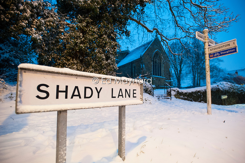 Snow and ice, St Deny's Church, Shady Lane, Evington Village, Leicester, England, UK.