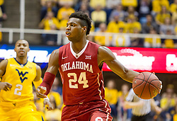 Feb 20, 2016; Morgantown, WV, USA; Oklahoma Sooners guard Buddy Hield (24) dribbles the ball during the first half against the West Virginia Mountaineers at the WVU Coliseum. Mandatory Credit: Ben Queen-USA TODAY Sports