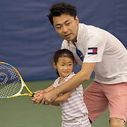 August 16, 2014, New Haven, CT:<br /> A father hits a tennis ball with his daughter during Kids Day on day three of the 2014 Connecticut Open at the Yale University Tennis Center in New Haven, Connecticut Sunday, August 17, 2014.<br /> (Photo by Billie Weiss/Connecticut Open)