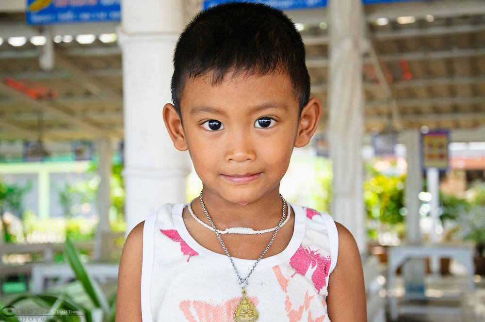 Thai child smiling, Ban Phe, Thailand
