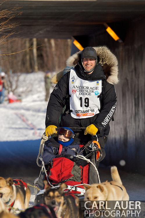 March 7th, 2009:  Anchorage, Alaska: Matt Hayashida from Willow, Alaska heads into the sunlight after going through a pedestrian tunnel next to the Alaska Native Hospital during the Ceremonial Start of the 2009 Iditarod.