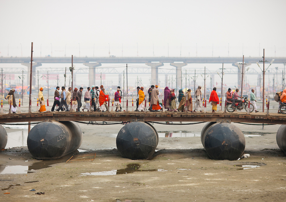 Pilgrims crossing a bridge during Maha Kumbh Mela festival, Allahabad, India.