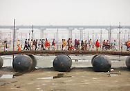 Pilgrims crossing a bridge during Maha Kumbh Mela festival, Allahabad, India.
