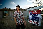 North Las Vegas, Nevada, USA, January 17th 2008: Kimberly Caneda is a real estate agent in a dire market. Here she is standing outside what used to be her own house, now lost to foreclosure.