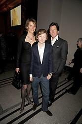 JOHN & LADY CAROLYN WARREN with their son ALEXANDER WARREN at a reception to celebrate the opening of 'Magnificence Of The Tsars' the new exhibition at the V&A held on 9th December 2008.