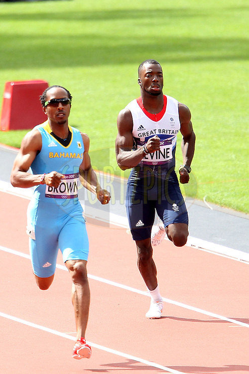 Nigel Levine of Great Britain and Chris Brown of BAH compete in the Men's 400m heats during day 2 of athletics held at the Olympic Stadium in Olympic Park in London as part of the London 2012 Olympics on the 3rd August 2012..Photo by Ron Gaunt/SPORTZPICS