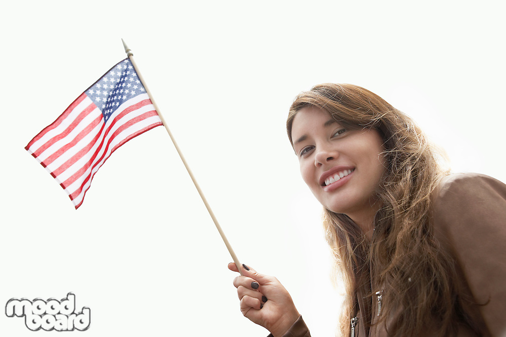 Young Woman Waving American Flag
