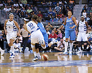 The Washington Mystic's Lindsey Harding and the Atlanta Dream's Shalee Lehning collide while going after a loose ball. In the hit and subsequent fall to the the floor, Lehning injured her left shoulder and left the game.