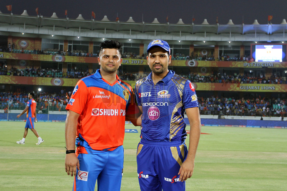 Mumbai Indians captain Rohit Sharma and Gujarat Lions captain Suresh Raina during the toss of the match 35 of the Vivo 2017 Indian Premier League between the Gujarat Lions and the Mumbai Indians  held at the Saurashtra Cricket Association Stadium in Rajkot, India on the 29th April 2017<br /> <br /> Photo by Vipin Pawar - Sportzpics - IPL