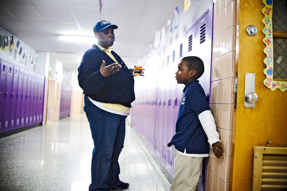Photo copyright 2009, Matt Roth<br /> Wednesday, February 29, 2012<br /> <br /> City Springs Elementary School first grader Jahmal Harrison, right, talks to his mother Tameka Harrison, after she found out he was in a fight with another student after school. Tameka, who can't work due to a facial injury, volunteers at her son's school where poverty is the norm. Ninety-six percent of the student body qualifies for free lunches. Tameka and Jahmal, who suffers from lead poisoning, used to live in one of the close-by housing projects, but have been homeless for the last two months. They're currently staying at Sarah's Hope Shelter in West Baltimore.