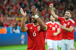 LILLE, FRANCE - Friday, July 1, 2016: Wales' captain Ashley Williams applauds the supporters at full time after the UEFA Euro 2016 Championship Quarter-Final match at the Stade Pierre Mauroy. (Pic by Paul Greenwood/Propaganda)