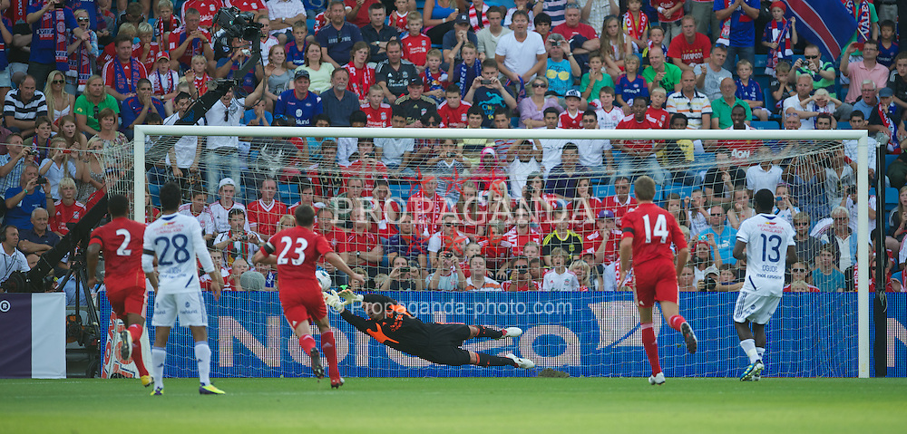 OSLO, NORWAY - Monday, August 1, 2011: Liverpool's goalkeeper Jose Reina is beaten from the penalty spot by Valerenga's Fegor Ogude for the second goal during a preseason friendly match at the Ulleval Stadion. (Photo by David Rawcliffe/Propaganda)