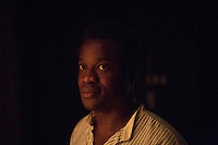 SLIEMA, MALTA - 8 FEBRUARY 2016: Actor Ladi Emeruwa, in the role of Hamlet,  poses for a portrait after petforming in the touring Hamlet, performed by the Shakespeare's Globe theatre company, at the Salesian Theatre in Sliema, Malta, on February 8th 2016.<br /> <br /> The touring Hamlet, performed by the Shakespeare's Globe theatre company, is part of the Globe to Globe tour that set off in April 2014 (on the 450th anniversary of Shakespeare's birth) with the ambitious intention of visiting every country in the world over 2 years. The crew is composed of a total of sixteen men and women: four stage managers and twelve twelve actors  actors perform over two dozen parts on a stripped-down wooden stage. So far Hamlet has been performed in over 150 countries, to more than 100,000 people and travelled over 150,000 miles. The tour was granted UNESCO patronage for its engagement with local communities and its promotion of cultural education. Hamlet was also played for many dsiplaced people around the world. It was performed in the Zaatari camp on the border between Syria and Jordan, for Central African Republic refugees in Cameroon, and for Yemeni people in Djibouti. On February 3rd it was performed to about 300 refugees in Calais at the camp known as the Jungle.