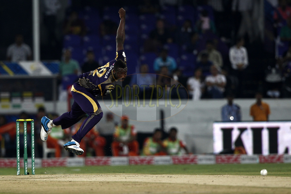 Andre Russell of the Kolkata Knight Riders bowls during match 7 of the Oppo Champions League Twenty20 between the Kolkata Knight Riders and the Lahore Lions held at the Rajiv Gandhi Cricket Stadium, Hyderabad, India on the 21st September 2014<br /> <br /> Photo by:  Deepak Malik / Sportzpics/ CLT20<br /> <br /> <br /> Image use is subject to the terms and conditions as laid out by the BCCI/ CLT20.  The terms and conditions can be downloaded here:<br /> <br /> http://sportzpics.photoshelter.com/gallery/CLT20-Image-Terms-and-Conditions-2014/G0000IfNJn535VPU/C0000QhhKadWcjYs