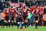 Ryan Fraser (24) of AFC Bournemouth and Steve Cook (3) of AFC Bournemouth celebrate the 2-1 win over Arsenal at full time during the Premier League match between Bournemouth and Arsenal at the Vitality Stadium, Bournemouth, England on 14 January 2018. Photo by Graham Hunt.