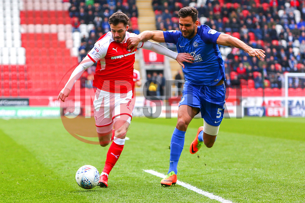 Ryan Tafazolli of Peterborough United puts pressure on Anthony Forde of Rotherham United - Mandatory by-line: Ryan Crockett/JMP - 30/03/2018 - FOOTBALL - Aesseal New York Stadium - Rotherham, England - Rotherham United v Peterborough United - Sky Bet League One