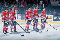 KELOWNA, CANADA - APRIL 18: Chase De Leo #9, Oliver Bjorkstrand #27, Derrick Pouliot #51, Anton Cederholm #2 and Taylor Leier #20 of the Portland Winterhawks line up against the Kelowna Rockets on April 18, 2014 during Game 1 of the third round of WHL Playoffs at Prospera Place in Kelowna, British Columbia, Canada.   (Photo by Marissa Baecker/Shoot the Breeze)  *** Local Caption *** Chase De Leo; Oliver Bjorkstrand; Derrick Pouliot; Anton Cederholm; Taylor Leier;