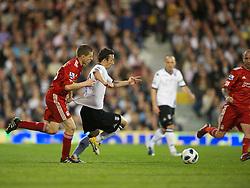 LONDON, ENGLAND - Monday, May 9, 2011: Liverpool's John Flanagan and Fulham's Simon Davies during the Premiership match at Craven Cottage. (Photo by David Rawcliffe/Propaganda)