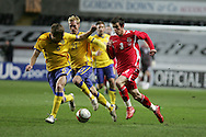 Gareth Bale of Wales goes past Sweden's Sebastian Larsson (6). International friendly, Wales v Sweden at the Liberty Stadium in Swansea on Wed 3rd March 2010. pic  by  Andrew Orchard