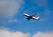 British Airways Airbus A320-232 aeroplane  taking off from Gatwick airport, London, UK