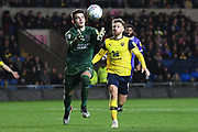 Shrewsbury Town defender goalkeeper (on loan from Bristol City) Max O'Leary (25) catches the ball under pressure from Oxford United forward (on loan from Bristol City) Matty Taylor (9) during the EFL Sky Bet League 1 match between Oxford United and Shrewsbury Town at the Kassam Stadium, Oxford, England on 7 December 2019.
