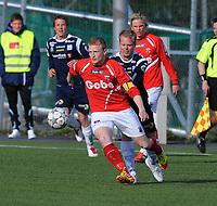 Fotball NM CUP Byåsen - Kristiansund<br /> 10 mai 2012<br /> Byåsen Arena, Trondheim<br /> <br /> Finn-Magnus Johannessen, Byåsen, med ballen. Bak : Christian Magnus Michelsen, Kristiansund<br /> <br /> <br /> Foto : Arve Johnsen, Digitalsport