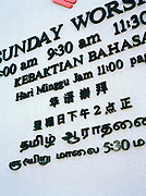 Sign at a church in Singapore's four official languages: English, Malay, Mandarin, and Tamil
