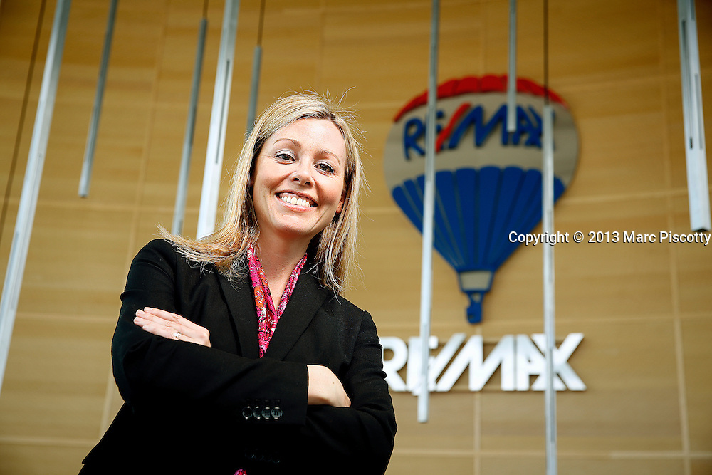 SHOT 5/15/13 11:02:18 AM - RE/MAX realtor Nicki Thompson of Arvada, Co. poses for a portrait at the company's Denver, Co. headquarters. She later spoke to prospective RE/MAX realtors about why she joined the company. (Photo by Marc Piscotty / © 2013)