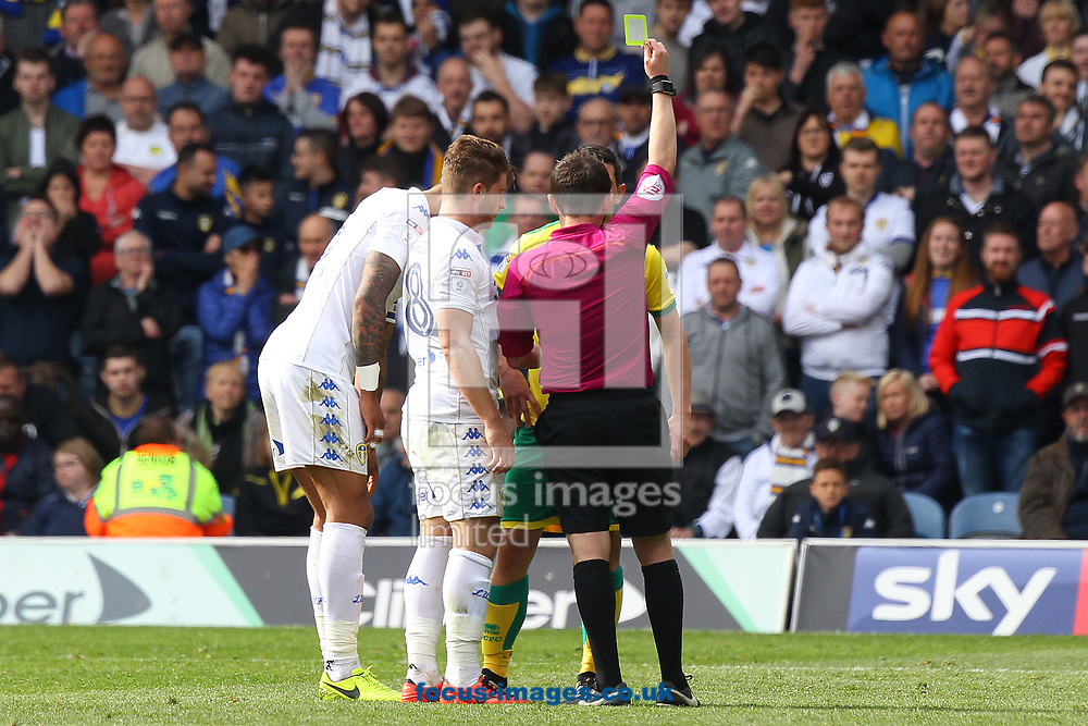 Graham Dorrans of Norwich gets a yellow card from Referee Tony Harrington after his clash with Gaetano Berardi of Leeds United during the Sky Bet Championship match at Elland Road, Leeds<br /> Picture by Paul Chesterton/Focus Images Ltd +44 7904 640267<br /> 29/04/2017